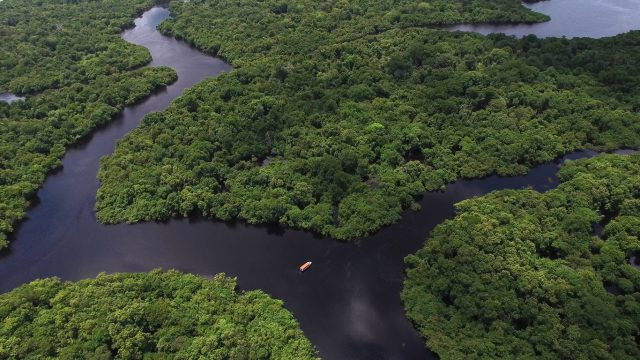 Travelling the Amazon River in a Century-Old Boat